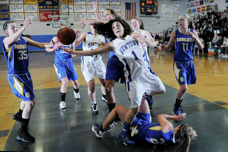 Newtown #1 Riley Wurtz reaches for an errant ball as Brookfield High School challenges Newtown High School in the semifinals of the Southwest Conference Girls Basketball Tournament at Bunnell High School in Stratford, CT on Tuesday, February 22, 2011. Photo: Shelley Cryan / Shelley Cryan