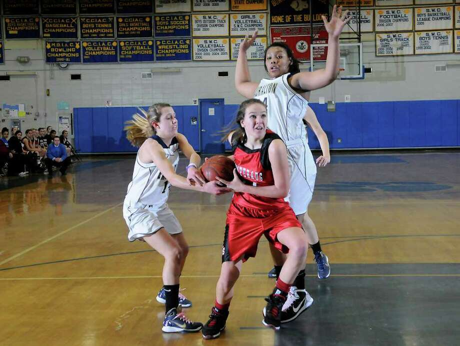 Pomperaug #11 Haili Welton battles with Lauralton #14 Michelle DeSantis as Pomperaug High School challenges Lauralton Hall High School in the semifinals of the Southwest Conference Girls Basketball Tournament at Bunnell High School in Stratford, CT on Tuesday, February 22, 2011. Photo: Shelley Cryan / Shelley Cryan