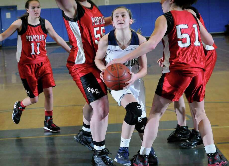 Lauralton's #12 Marisa Dowling looks for an opening as Pomperaug High School challenges Lauralton Hall High School in the semifinals of the Southwest Conference Girls Basketball Tournament at Bunnell High School in Stratford, CT on Tuesday, February 22, 2011. Photo: Shelley Cryan / Shelley Cryan