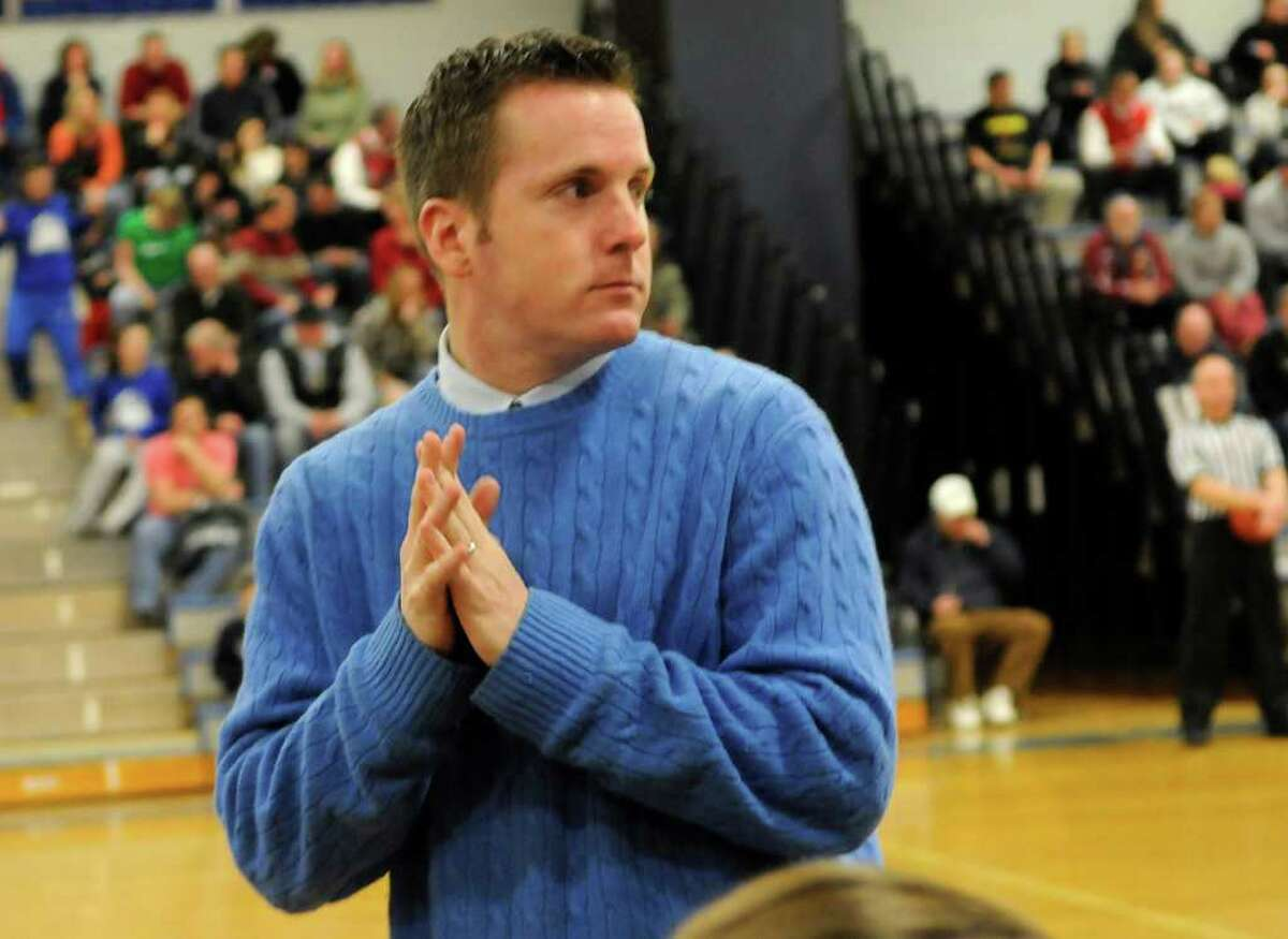 Pomperaug coach Joe Fortier is courtside before the game as Pomperaug High School challenges Lauralton Hall High School in the semifinals of the Southwest Conference Girls Basketball Tournament at Bunnell High School in Stratford, CT on Tuesday, February 22, 2011.