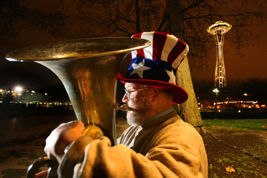 "Edward McMichael, known to thousands as ""Tuba Man,"" is shown here outside a Sonics home game on Nov. 9, 2007. He died less than a year later after three teens attacked him. Photo: Scott Eklund/seattlepi.com File"