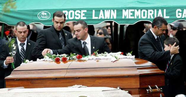 Family, friends and supporters place roses on the casket of Immigrations and Customs Enforcement Special Agent Jaime Zapata in Brownsville on Feb. 22. Photo: JERRY LARA / glara@express-news.net