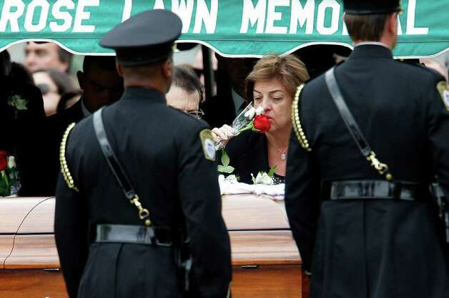 Mary Zapata kisses a rose before placing it on her son's casket during burial services for Immigrations and Customs Enforcement Special Agent Jaime Zapata at Rose Lawn Memorial Cemetery in Brownsville on Feb. 22, 2011. The agent was killed by unknown assailants on Feb. 15 in the Mexican state of San Luis Potosi. Photo: JERRY LARA / glara@express-news.net