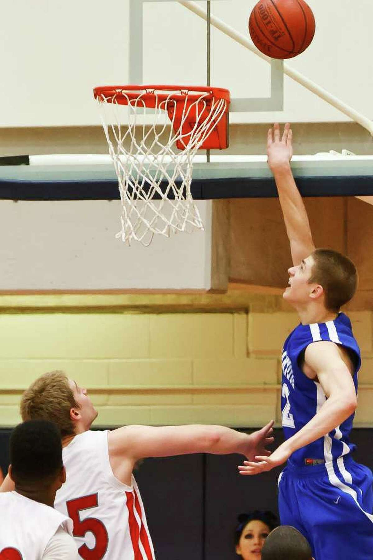 MacArthur's Matt Gramling (right) puts up a layup with 4.6 seconds remaining in overtime that proved to be the game-winning basket in the Brahmas' 56-54 second-round playoff victory over Judson at Paul Taylor Field House on Tuesday, Feb. 22, 2011.