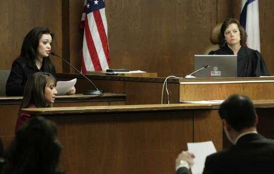 Domonique Ramirez, 17, (left) speaks on the stand during the trial against the Miss Bexar County Organization on Feb. 22. Photo: JOHN DAVENPORT / jdavenport@express-news.net