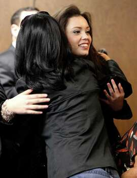 Domonique Ramirez (facing) gets a hug during a break in the trial in which she is suing the Miss Bexar County Organization, Inc. Photo: JOHN DAVENPORT / jdavenport@express-news.net