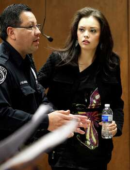 Domonique Ramirez (right) pauses in court Tuesday during the trial in which she is suing Miss Bexar County Organization, Inc. Photo: JOHN DAVENPORT / jdavenport@express-news.net