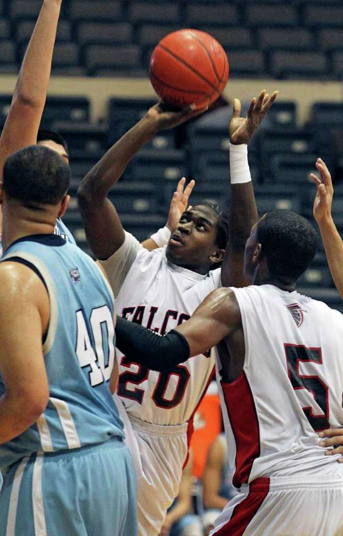 Falcons player Javon Joseph gets a shot off in heavy traffic as Stevens plays South San in the boys basketball playoffs at Greehey Arena on Tuesday, Feb. 22, 2011.