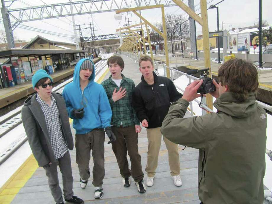 The FWHS Acafellas, an a cappella group made up of Fairfield Warde High School teens, shoot a video along the train track in downtown Fairfield Monday afternoon. The group members, from left to right, are Johnny Shea, Sam Warnick, Zach Parfitt and Tim Veit. Photo: Kirk Lang / Fairfield Citizen