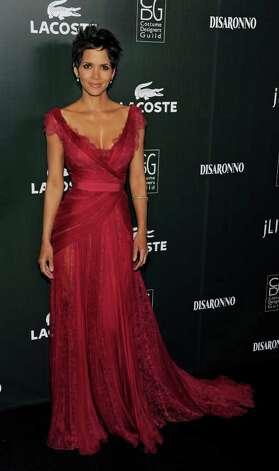 Lacoste Spotlight Award recipient Halle Berry arrives at the 13th Annual Costume Designers Guild Awards in Beverly Hills, Calif., Tuesday, Feb. 22, 2011. Photo: AP
