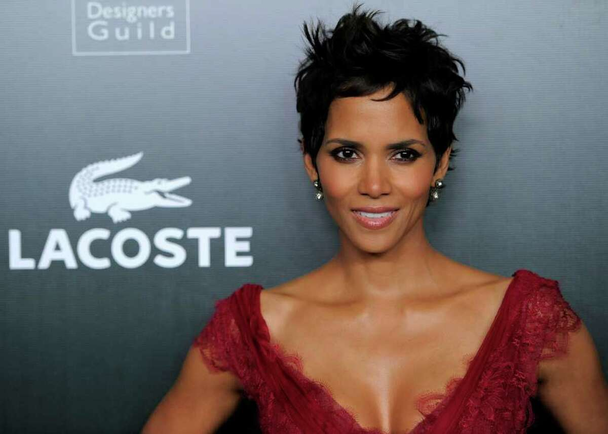 Lacoste Spotlight Award recipient Halle Berry poses at the 13th Annual Costume Designers Guild Awards in Beverly Hills, Calif., Tuesday, Feb. 22, 2011.