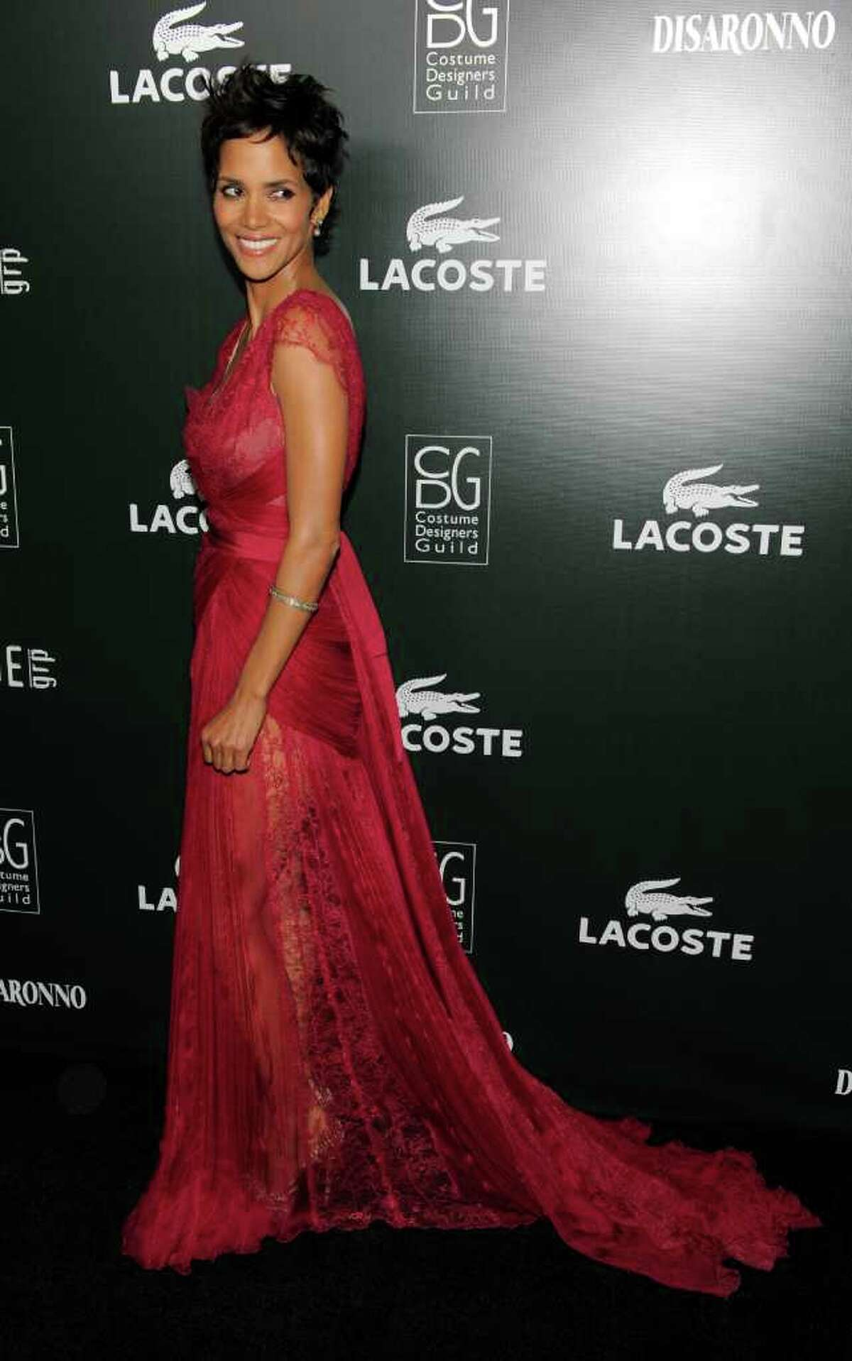 Lacoste Spotlight Award recipient Halle Berry turns back for photographers at the 13th Annual Costume Designers Guild Awards in Beverly Hills, Calif., Tuesday, Feb. 22, 2011.