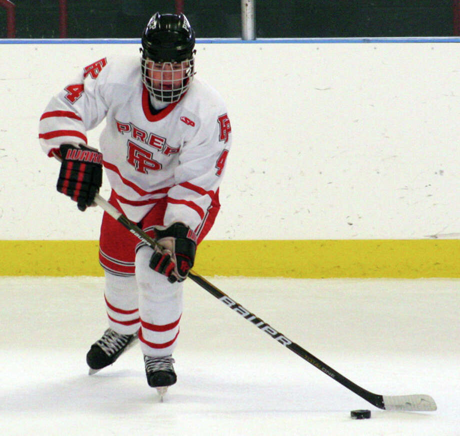 Fairfield Prep's Sean Henry passes the puck during the Jesuits' 3-2 loss to Notre Dame-West Haven on Saturday afternoon at Wonderland of Ice. Photo: Tim Parry / Fairfield Citizen freelance