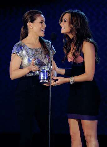 HOLLYWOOD - JULY 19:  Actress Alyssa Milano (L) accepts the Twitter Award from Demi Lovato onstage at the 2010 VH1 Do Something! Awards held at the Hollywood Palladium on July 19, 2010 in Hollywood, California.  (Photo by Michael Caulfield/Getty Images for VH1) *** Local Caption *** Alyssa Milano;Demi Lovato Photo: Michael Caulfield, Getty Images For VH1 / 2010 Getty Images