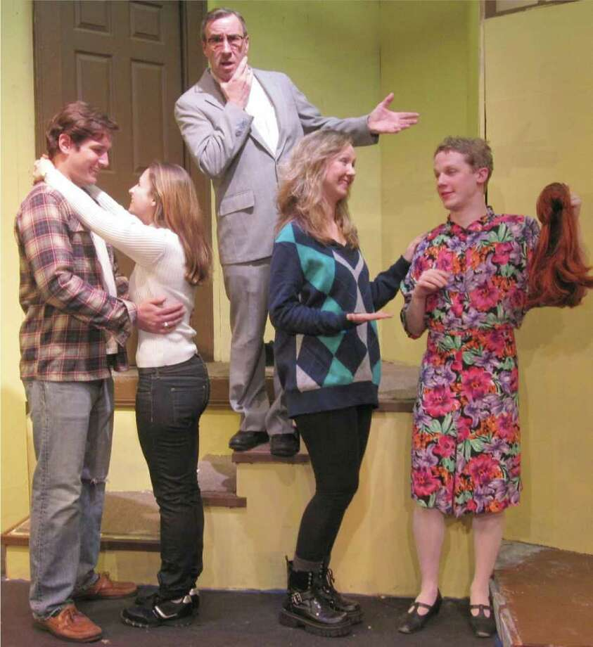 Internal Revenue Service agent Floyd Spinner, played by Bob Filipowich, presides over the happily reunited couples Jon and Kate, played by Townsend Ambrecht and Marta Coppola, and Connie and Leslie, played by Rochelle Woodson and Ryan Hendrickson. For more of the story, see the Town Players of New Canaan's production of Billy VanZandt and Jane Milmore's comedy 'Love, Sex and the I.R.S.,' playing Feb. 25 to March 12 at the Powerhouse Theatre in Waveny Park, New Canaan. To reserve seats, call 203-966-7371. Contributed photo/Cindy Ording Photo: Contributed Photo / Stamford Advocate Contributed