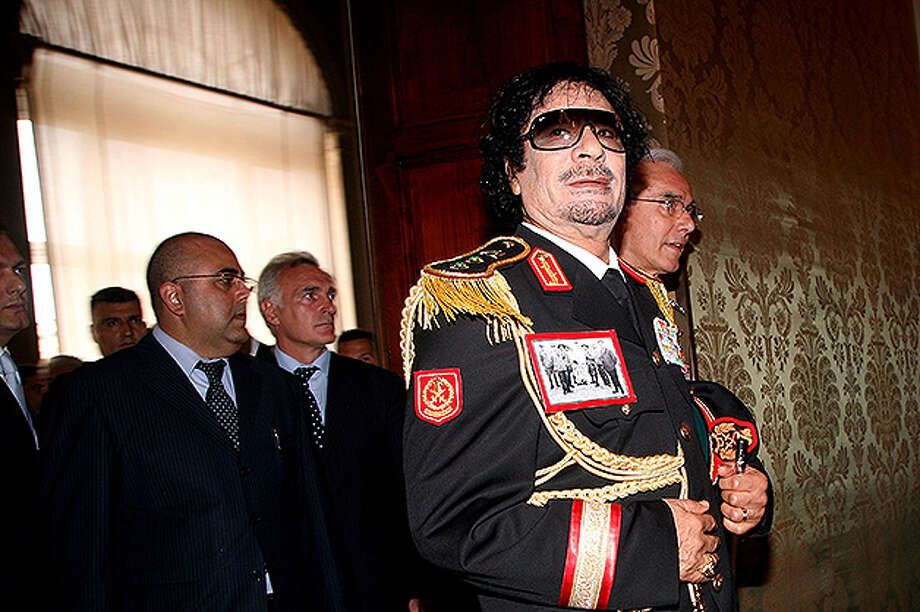 He digs sunglasses, the military look and draping himself in flowing silk robes. He is a man of man looks. He is Moammar Gadhafi, the world's most flamboyant dictator. Photo: Franco Origlia, Getty Images / Getty Images 2011