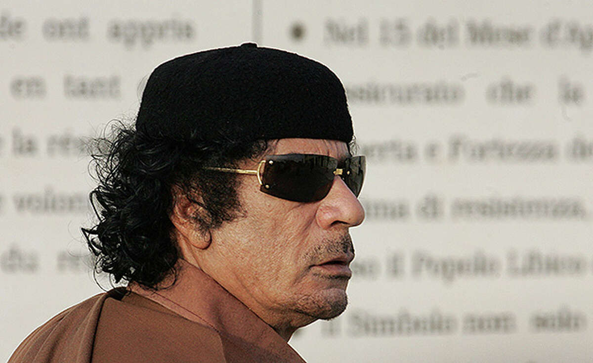 Libyan leader Moammar Gadhafi waits to meet with President Vladimir Putin of Russia on April 16, 2008 In Tripoli, Libya. Putin is in Libya for a two-day official visit to rebuild Russian-Libyan relations.