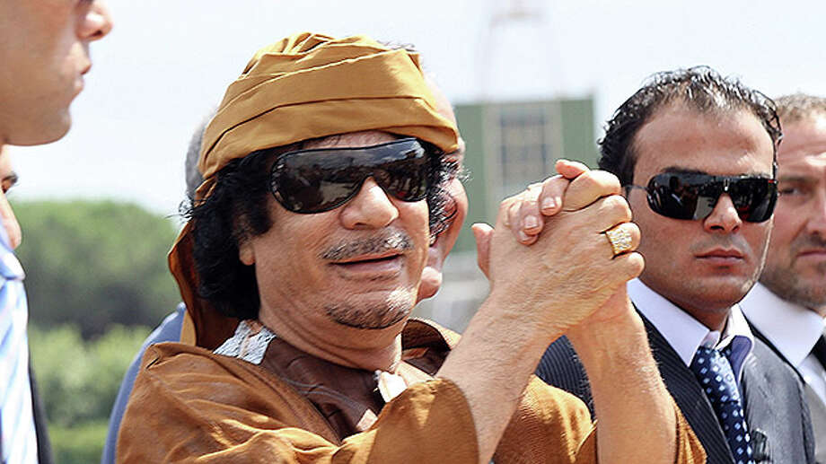 Libyan leader Moammar Gadhafi arrives at the Ciampino airport on August 29, 2010 in Rome, Italy. Gadaffi is on an official two-day visit to Italy for talks with Prime Minister Silvio Berlusconi. Photo: Ernesto Ruscio, Getty Images / Getty Images 2011