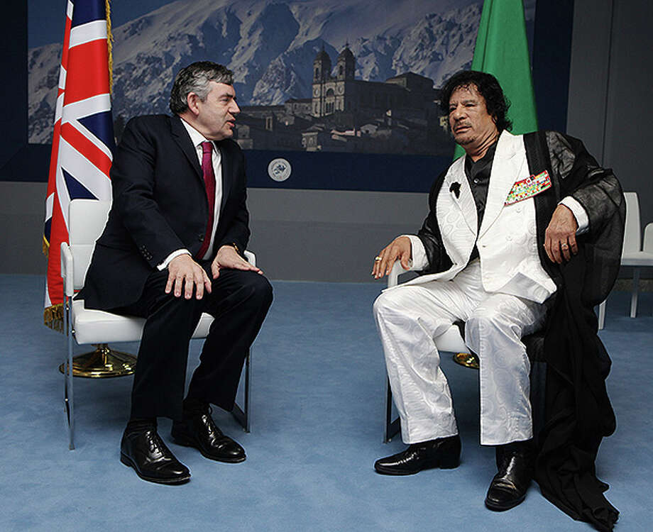 British Prime Minister Gordon Brown holds a bilateral meeting with Libyan Leader Moammar Gadhafi on the morning of the third day of the G8 summit on July 10, 2009 in L'Aquila, Italy. Photo: Oli Scarff, Getty Images / Getty Images 2011