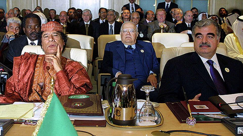 Libyan President Moammar Gadhafi and Rafiq al-Hariri, the Prime Minister of Lebanon, attend the Arab