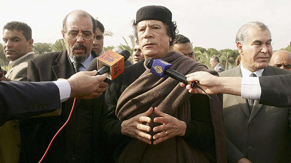 Lybian leader Moammar Gadhafi addresses to the media on November 25, 2004 in Tripoli.