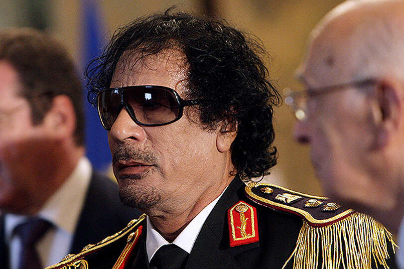 Libya's leader Moammar Gadhafi attends a meeting with Italian President Giorgio Napolitano at the Qu