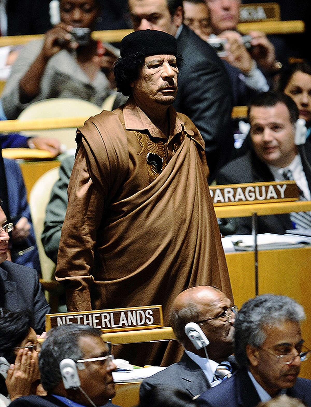 Libyan leader Colonel Moammar Gadhafi walks through the chamber at the 64th General Assembly at United Nations Headquarters on September 23, 2009 in New York City.