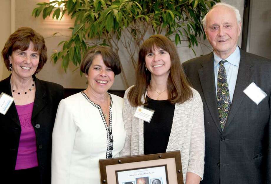 Shari Shapiro, Executive Director of Cos Cob-based Kids in Crisis, and Emily Tow Jackson, Executive Director of The Tow Foundation, were recently named winners of the 2011 Fairfield County Champion of Children Award, presented by The Center for Children's Advocacy (CCA).  The two received their awards at a recent event held at Trump Parc.  Shown here at the ceremony are Martha Stone, Executive Director, CCA, Ms. Shapiro, Ms. Tow Jackson and Leonard Tow, Chairman of The Tow Foundation.  The two women were recognized for their ongoing, outstanding effort in support of Connecticut children and youth who suffer without stable homes, families or education and medical support services.  Kids in Crisis, established in 1978, provides free, emergency counseling and shelter services to families and children of all ages. Photo: Contributed Photo / Greenwich Citizen