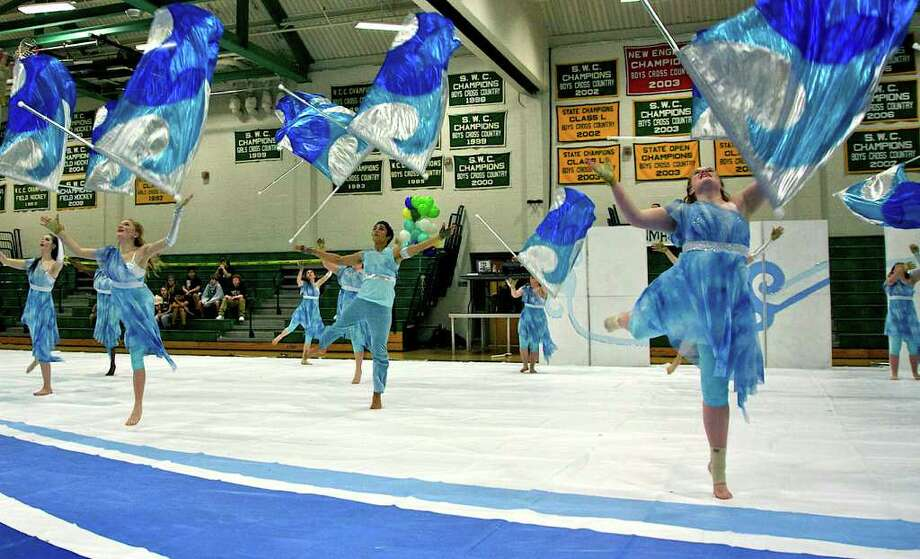 SPECTRUM/Lindsey Brown, right foreground, and her New Milford High School color guard teammates perform Saturday, Feb. 19, 2011 as the NMHS team hosted its annual mutli-school drum line and color guard festival. Photo: Trish Haldin / The News-Times Freelance