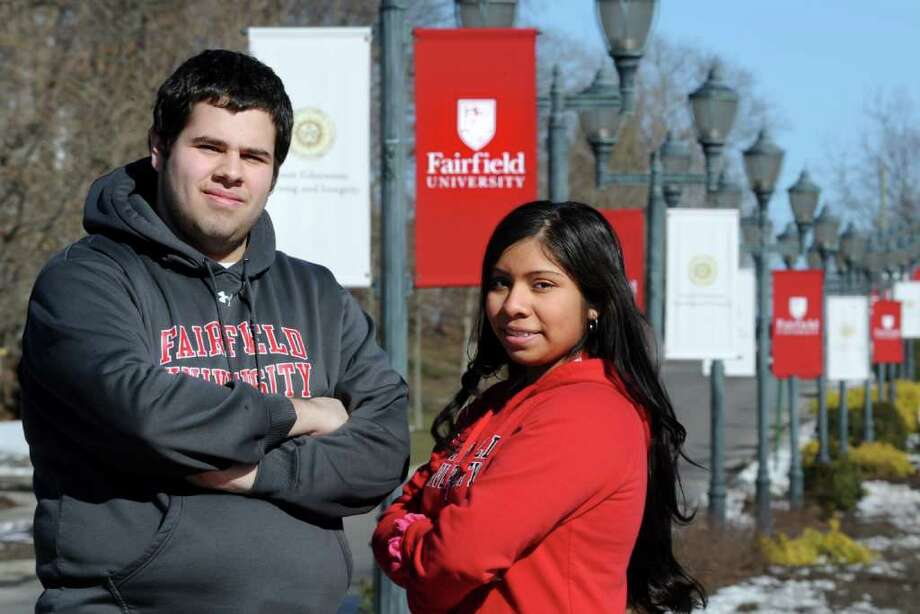 Fairfield University freshmen Eric Salgado and Sonia Castelan-Ramires stand outside their school Wednesday, Feb. 23, 2011.  Both receive state aid to attend the private college but Gov. Dannel P. Malloy's budget will drastically decrease funds. Photo: Autumn Driscoll / Connecticut Post