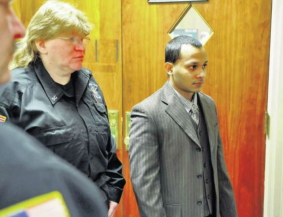 Defendant  Adrian Parbhudial, right,  is led by Schenectady County Sheriff's Department members into a holding room outside of a courtroom in the Schenectady County Courthouse during a break in his trial in Schenectady on Feb. 16. A jury found him guilty Feb. 23 of attempted aggravated murder for firing into two police officers in 2010.  ( Philip Kamrass / Times Union ) Photo: PHILIP KAMRASS