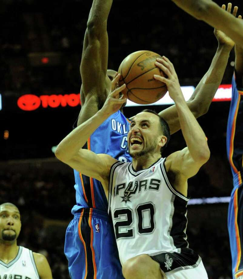 Manu Ginobili, the San Antonio Spurs' leading scorer, drives against the Oklahoma City Thunder during first-half NBA action at the AT&T Center on Wednesday, Feb. 23, 2011. BILLY CALZADA / gcalzada@express-news.net