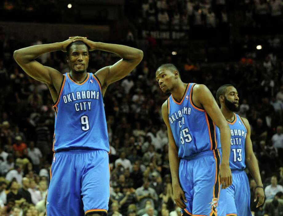 Serge Ibaka (9), Kevin Durant (35) and James Harden (13) of the Oklahoma City Thunder react as time runs out on their 109-105 loss to the San Antonio Spurs at the AT&T Center on Wednesday, Feb. 23, 2011. BILLY CALZADA / gcalzada@express-news.net