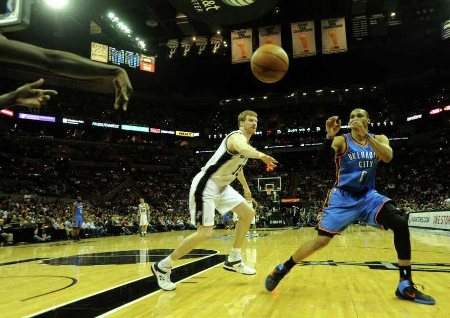 Matt Bonner of the San Antonio Spurs (15) defends as Russell Westbrook of the Oklahoma City Thunder receives an inbounded pass during second-half NBA action at the AT&T Center on Wednesday, Feb. 23, 2011. BILLY CALZADA / gcalzada@express-news.net