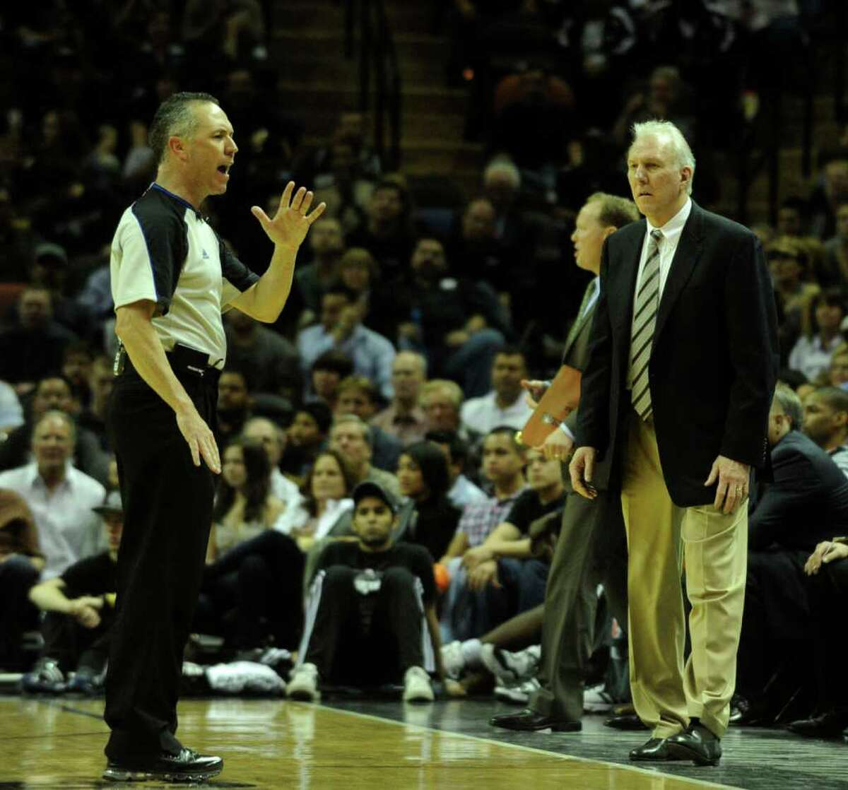 San Antonio Spurs coach Gregg Popovich watches as official Jason Phillips makes a call against his team during second-half NBA action against the Oklahoma City Thunder at the AT&T Center on Wednesday, Feb. 23, 2011. BILLY CALZADA / gcalzada@express-news.net Oklahoma City Thunder at San Antonio Spurs