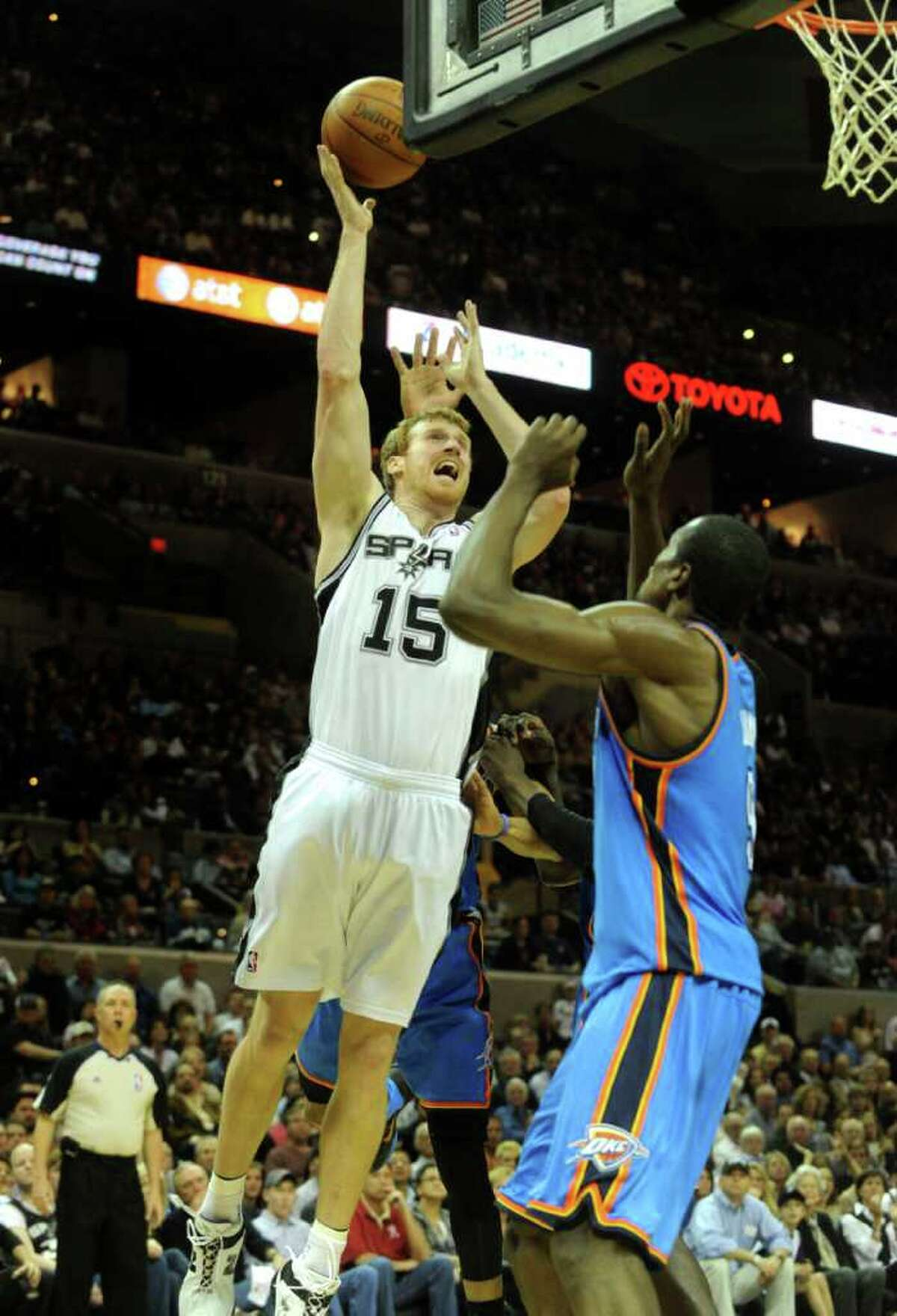 Matt Bonner of the San Antonio Spurs shoots over Serge Ibaka of the Oklahoma City Thunder during second-half NBA action at the AT&T Center on Wednesday, Feb. 23, 2011. BILLY CALZADA / gcalzada@express-news.net Oklahoma City Thunder at San Antonio Spurs