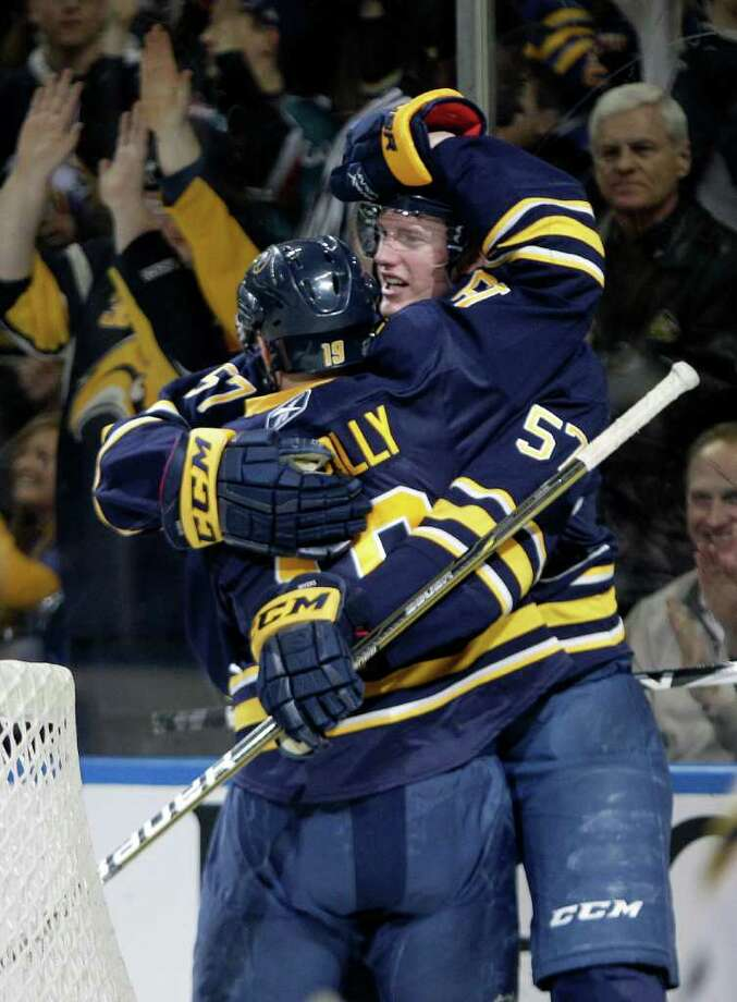Buffalo Sabres' Tyler Myers (57) celebrates his goal with Tim Connolly (19) against the Atlanta Thrashers during the first period of an NHL hockey game in Buffalo, N.Y., Wednesday, Feb. 23, 2011. (AP Photo/David Duprey) Photo: David Duprey