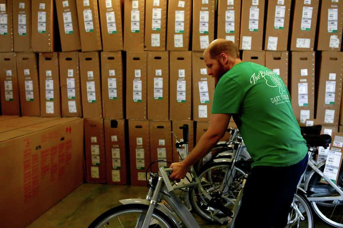 Caleb Choate, a mechanic at Bike World, works to assemble 140 bikes to be used for San Antonio's new B-cycle bike sharing program at the main office for the program in HemisFair Park on Wednesday, Feb. 23, 2011.