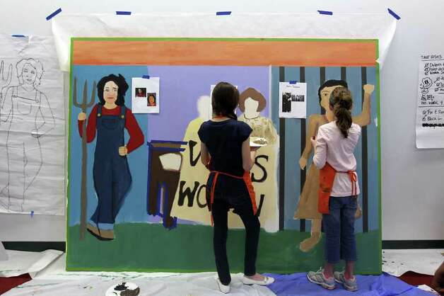 "Participants put the final touches on the mural themed ""Girls have the right to take risks, strive freely, and take pride in success"", February 19, 2011. Girls Inc. of San Antonio and SAY Si partnered to create a mobile mural called Herstory. The six-panel mural immortalizes women trailblazers and activists who paved the path for women today, including Sandra Cisneros, Maria Antonietta Berriozabal, Ann Richards and Emma Tenayuca. The mural will be unveiled Feb. 26. Photo: JENNIFER WHITNEY, Special To The Express-News / special to the Express-News"