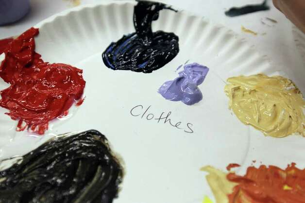 A detail of paints colors for the women's clothing on a table as participants put the final touches on the murals, February 19, 2011. Girls Inc. of San Antonio and SAY Si partnered to create a mobile mural called Herstory. The six-panel mural immortalizes women trailblazers and activists who paved the path for women today, including Sandra Cisneros, Maria Antonietta Berriozabal, Ann Richards and Emma Tenayuca. The mural will be unveiled Feb. 26. Photo: JENNIFER WHITNEY, Special To The Express-News / special to the Express-News