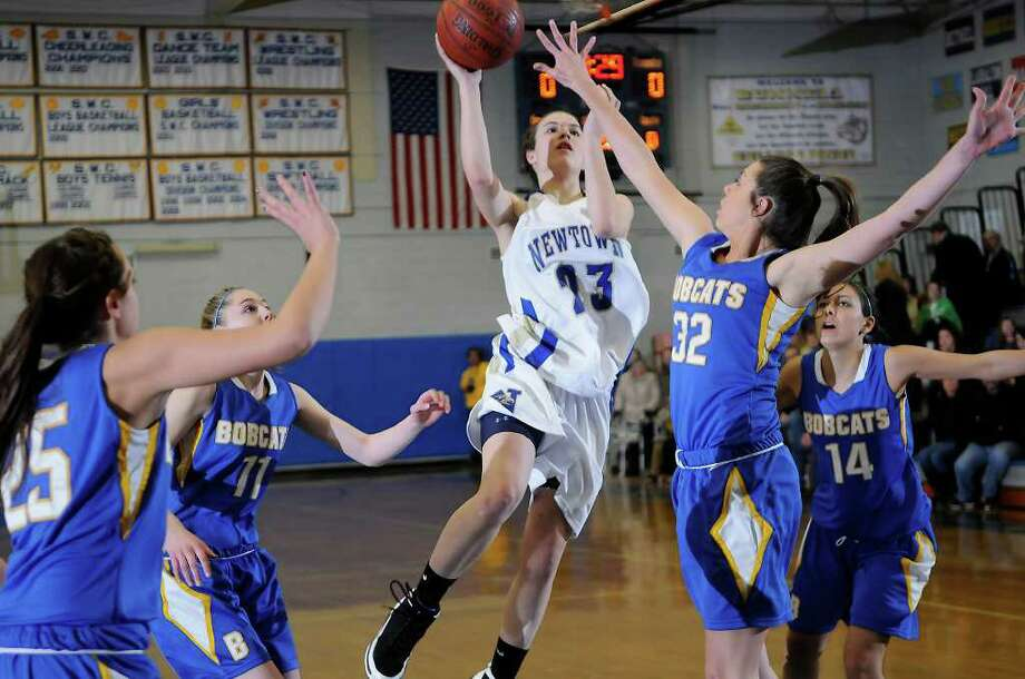 Newtown #23 Bridget Power goes for two above Brookfield # 32 Jamie Bickelhaupt as Brookfield High School challenges Newtown High School in the semifinals of the Southwest Conference Girls Basketball Tournament at Bunnell High School in Stratford, CT on Tuesday, February 22, 2011. Photo: Shelley Cryan / Shelley Cryan