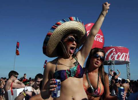 "FOR  METRO - Chelsea Stickler (left) and Lindsey Hobbs party Wednesday March 17, 2010 during ""Texas Week"" at Coca-Cola Beach on South Padre Island, TX. (PHOTO BY EDWARD A. ORNELAS/eaornelas@express-news.net) Photo: EDWARD A. ORNELAS, SAN ANTONIO EXPRESS-NEWS / eaornelas@express-news.net"