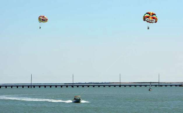 "FOR  METRO - Spring breakers parasail in the Laguna Madre Wednesday March 17, 2010 during ""Texas Week"" on South Padre Island. (PHOTO BY EDWARD A. ORNELAS/eaornelas@express-news.net) Photo: EDWARD A. ORNELAS, SAN ANTONIO EXPRESS-NEWS / eaornelas@express-news.net"