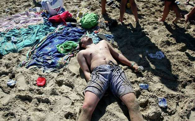 "FOR  METRO - A spring breaker relaxes on Coca-Cola Beach on South Padre Island Wednesday March 17, 2010 during ""Texas Week."" (PHOTO BY EDWARD A. ORNELAS/eaornelas@express-news.net) Photo: EDWARD A. ORNELAS, SAN ANTONIO EXPRESS-NEWS / eaornelas@express-news.net"