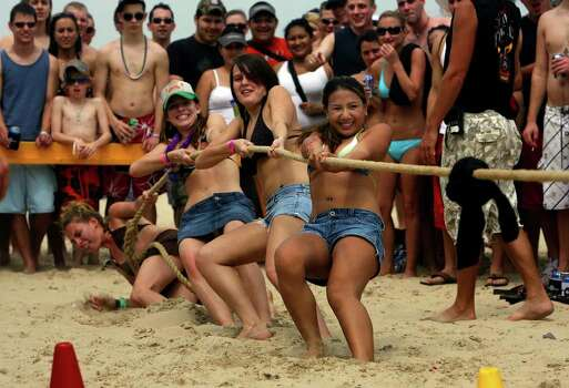 University of Texas students Jackie Lapid (front to rear), Ragan (cq) Meeks, Nicoloe Johns, and Angie Helvey take part in a tug of war game on South Padre Island on Thursday March 15, 2007 during Spring Break. The girls beat their opponents fron Texas State University. JOHN DAVENPORT / STAFF Photo: JOHN DAVENPORT, SAN ANTONIO EXPRESS-NEWS / SAN ANTONIO EXPRESS-NEWS