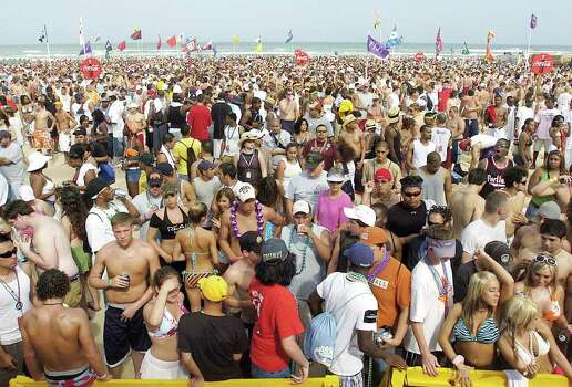 A sea of spring breakers chat, drink and gather around a stage as they wait for the Sexy Dance contest on Thursday, March 16, 2006 on the beaches of South Padre Island, Texas. Photo: GABE HERNANDEZ, AP / VALLEY MORNING STAR