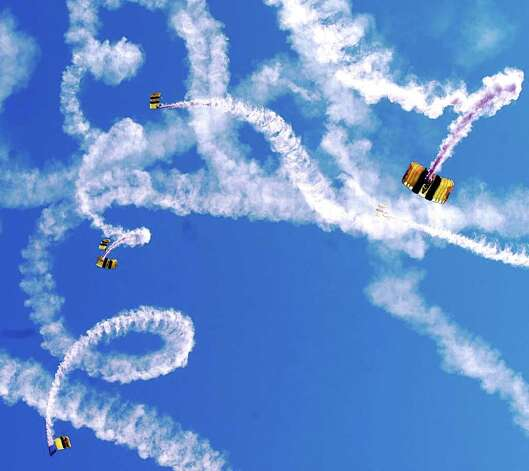 The Golden Knights free fall to the beaches of South Padre Island, Texas, Wednesday, March 17, 2004, during Spring Break 2004. The Army's' elite parachute team will be conducting two more performances this week with jumps scheduled Thursday and Saturday at 1 p.m. Photo: RIC VASQUEZ, AP / VALLEY MORNING STAR