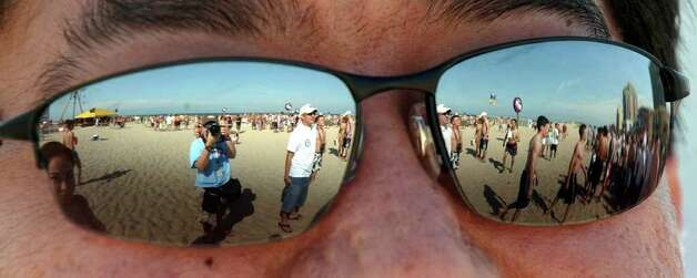 STATE/DAILY/ SPRING BREAK 2004:  Leo Martinez shades his eyes from the sun at Spring Break 2004 on South padre Island Friday March 12, 2004. DELCIA LOPEZ/STAFF Photo: DELCIA LOPEZ, SAN ANTONIO EXPRESS NEWS / SAN ANTONIO EXPRESS NEWS