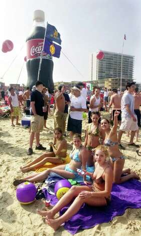 Spring Breakers hang out and sunbathe around the Coca-Cola beach by the Radisson Hotel on South Padre Island Thursday March 14, 2002. Photo by Matthew Hinton Photo: Matthew Hinton / Valley Morning Star