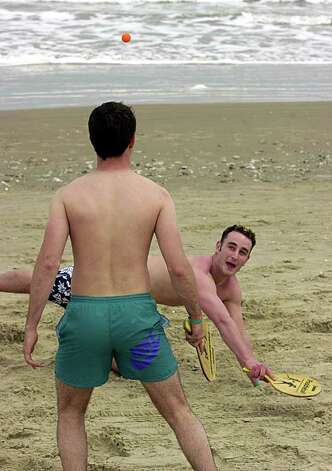 STATE/DAILY/ Spring Break SPI:  Mike O'Rourke,21,of Michigan State and Will Bransdorfer,20, of the University of Michigan play paddle ball at South Padre Island Wednesday Feb.6, 2002. STAFF PHOTO BY DELCIA LOPEZ Photo: DELCIA LOPEZ, SAN ANTONIO EXPRESS NEWS / SAN ANTONIO EXPRESS NEWS